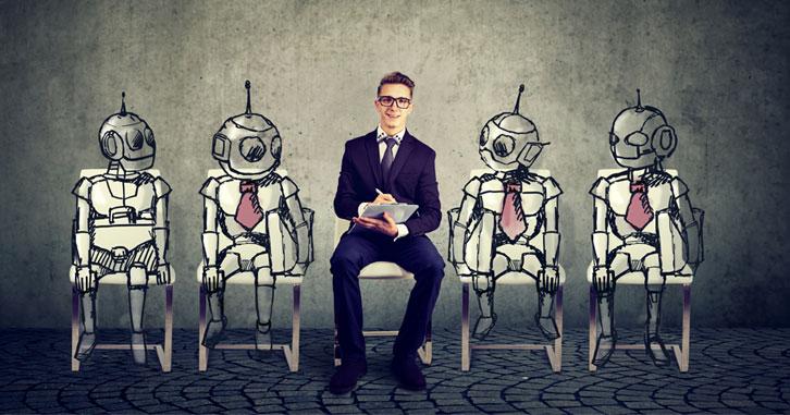 Man in suit sitting between robots in suits